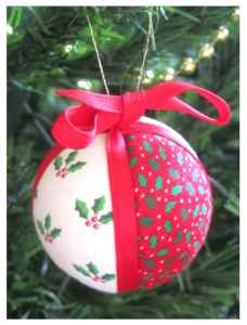 This homemade decoration is made using a polystyrene ball, fabric and ribbon.